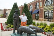 Andy by the farmer and pig sculpture outside
