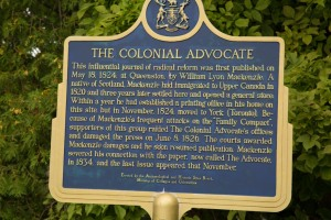 Colonial Advertiser newspaper sign