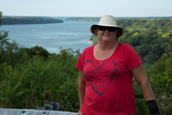 Queenston - Judi at a viewpoint with lower reaches of Niagara River in the background
