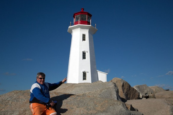 Peggys Cove Andy pointing to the lighthouse