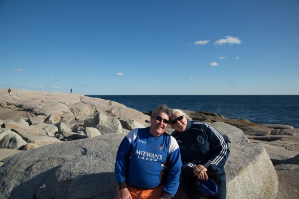 Peggys Cove with Andy and Judi on the rocks below the light