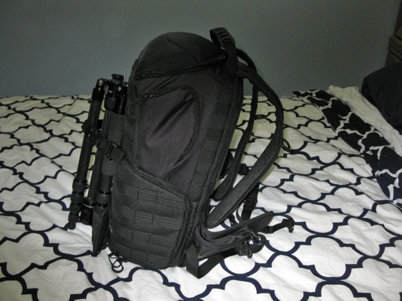 Two camera bodies, lenses, flash, extra external hard drive, laptop and tripod all in a single backpack