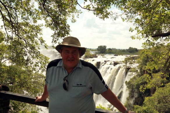 Andy with Victoria Falls in background