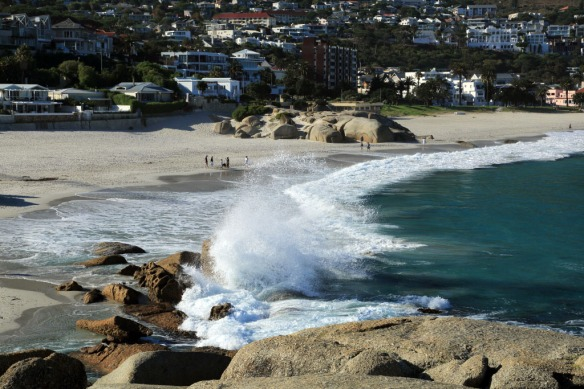 Camps Bay beach with the surf pounding ashore