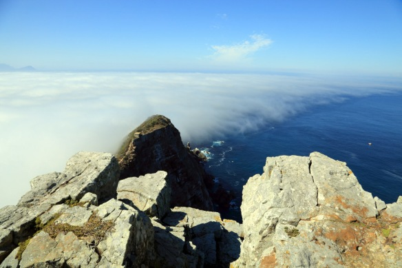 Cape Point Light looking to the end of the point and the line of fog