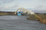 Cruise boat transiting the narrow entrance to the Falkirk Wheel