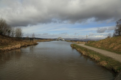 Falkirk Wheel and aquaduct with clouds rolling in