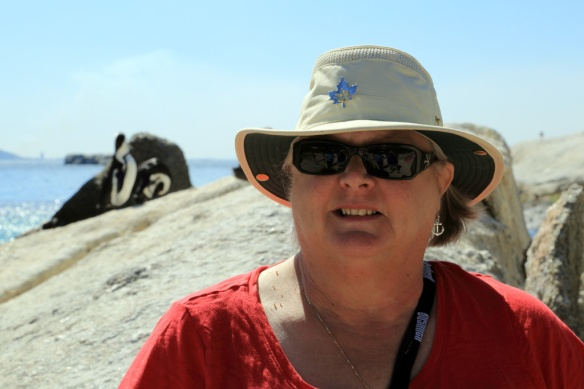 Judi at Boulders Beach with penguins in background