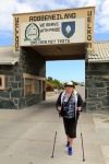 Judi-at-the-Robben-Island-sign-at-the-harbour.jpg