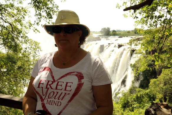 Judi with Victoria Falls in background