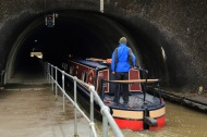 Narrow canal boat entering the tunnel