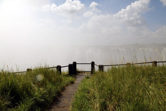 Victoria Falls partially obscured by spray