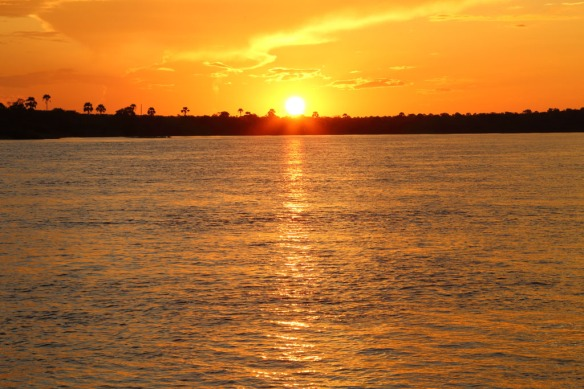 Zambezi River Cruise at sunset with sunbursts