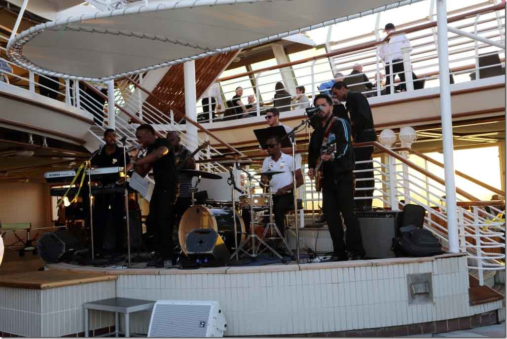 Band backed up by orchestra wind instruments at world cruise kick-off party