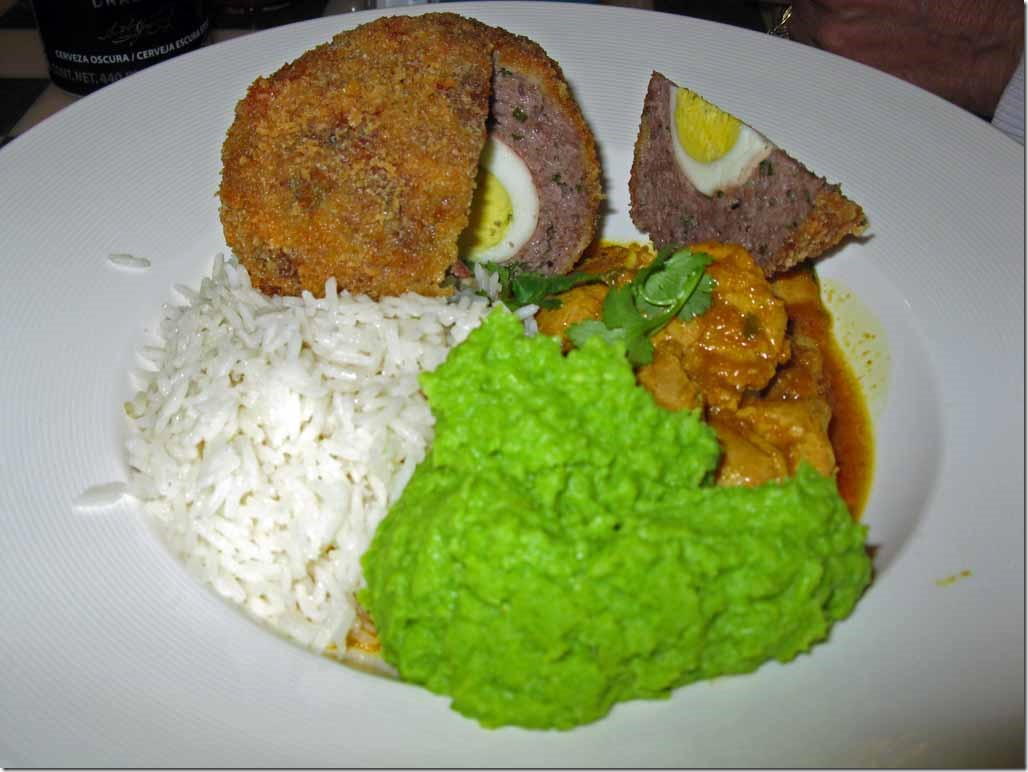 Chicken curry with scotch egg and mushy peas