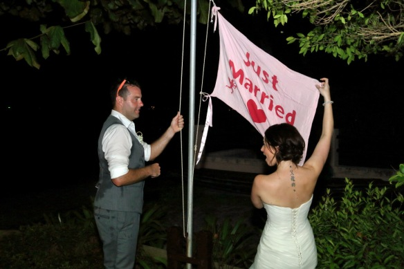 Heidi and Iain raising the Just Married flag