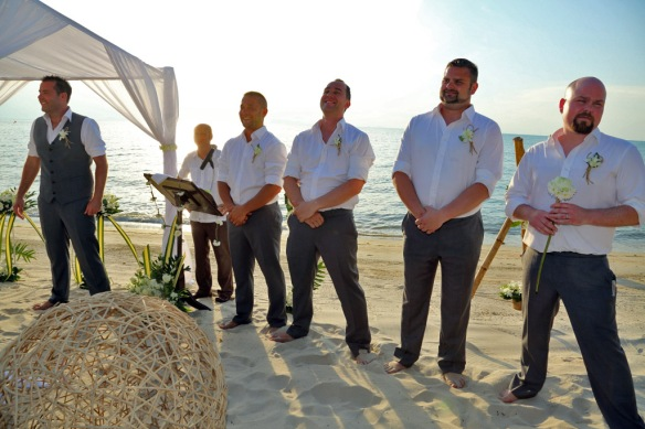 Iain and groomsmen waiting at the altar, is Heidi coming