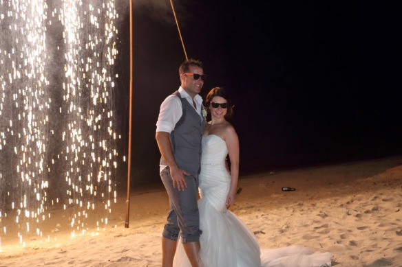 Iain and Heidi on beach by curtain of light