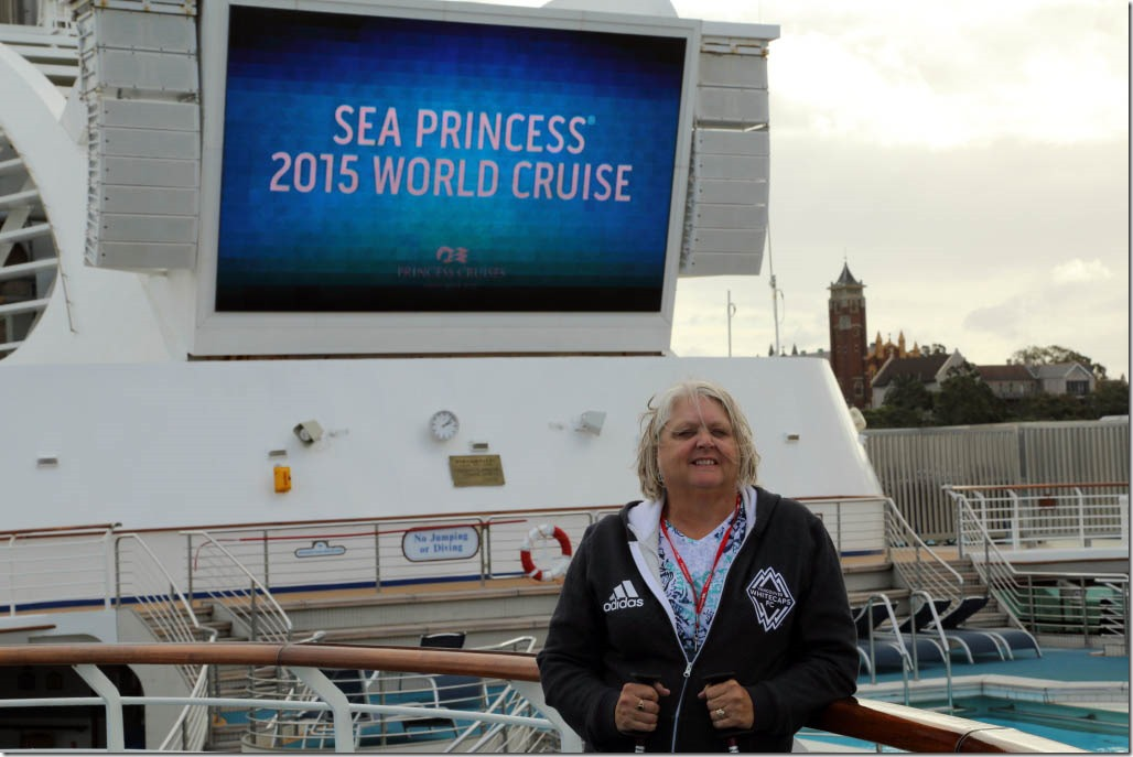 Judi close-up with World Cruise sign in background