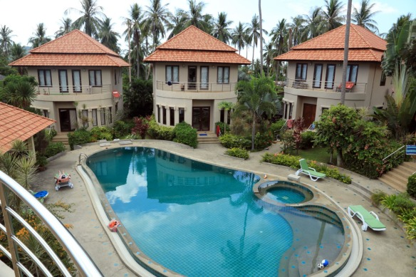 Complex pool and three of the six villas