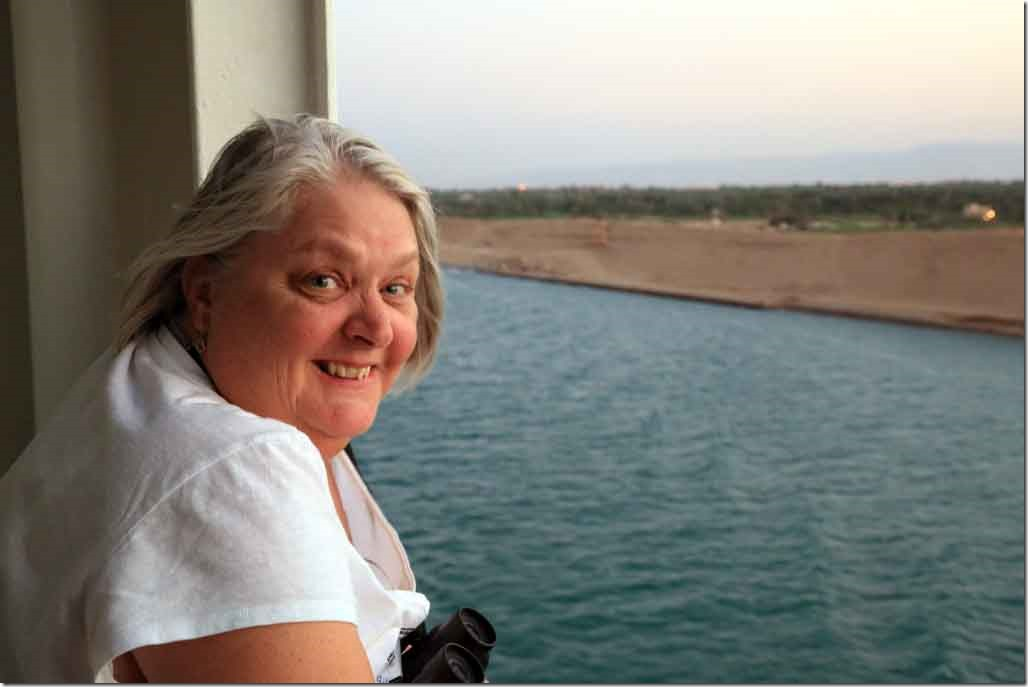 Canal transit Judi on balcony after sunset