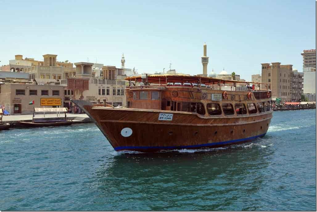 Cruise boat heading up Dubai Creek