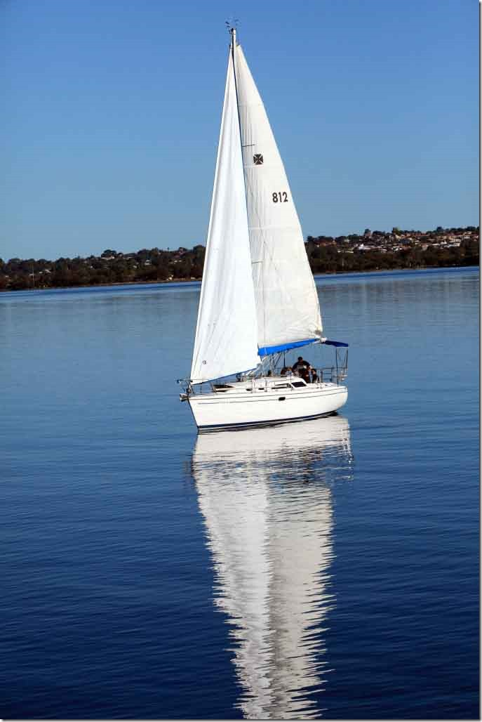 Cruise, sailboat heading up river