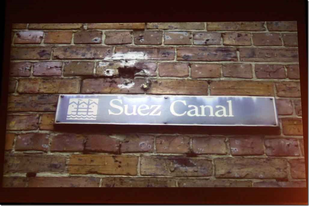 Enrichment Lecture Suez Canal with street sign from Sydney