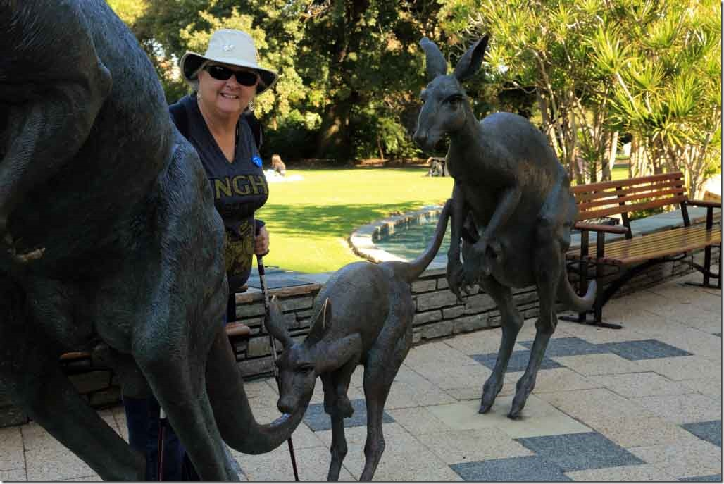 Judi at the Kangaroo Statues in park in front of Supreme Court