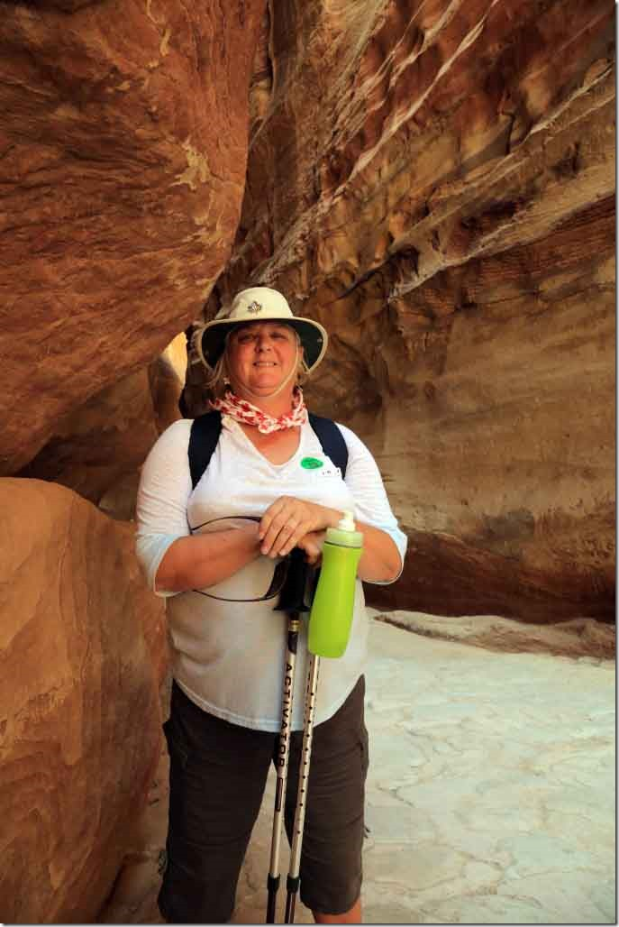 Petra Siq with Judi in the narrow section before the Treasury building