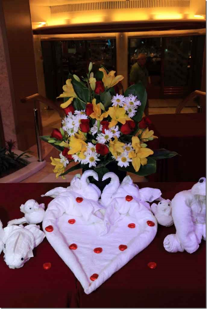 Towel Art - Heart shaped swans and flower arrangement