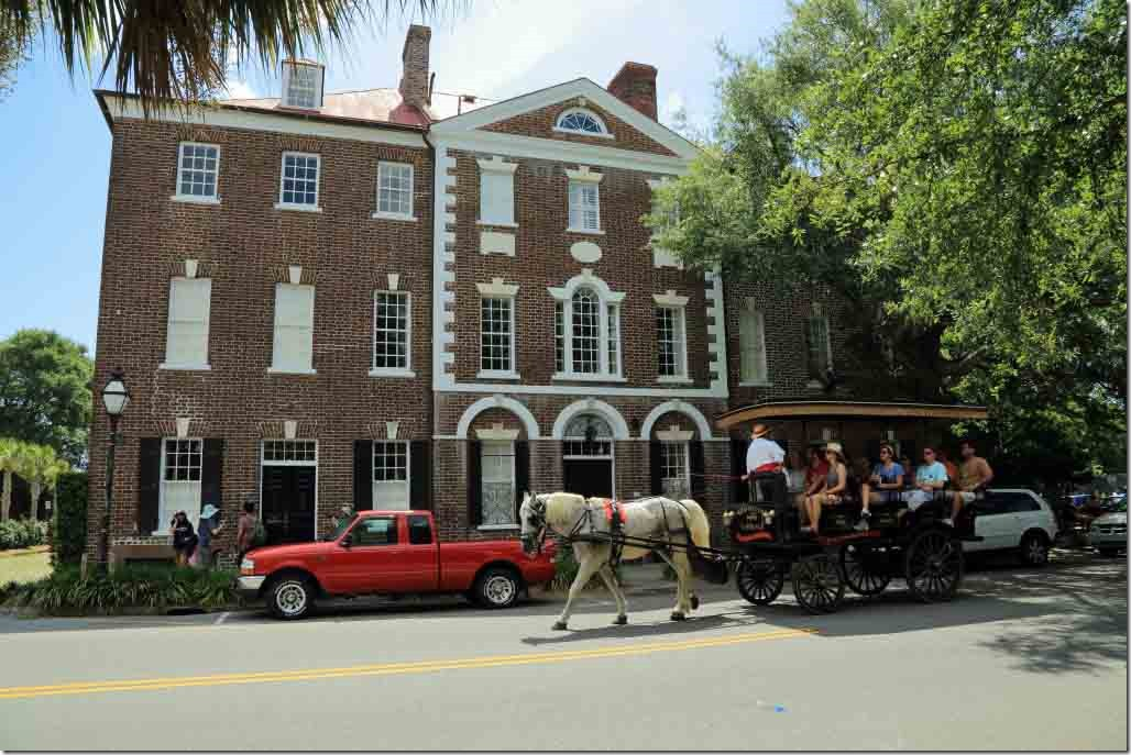 Charleston walk horse drawn carriage passing an old house on Bay Street