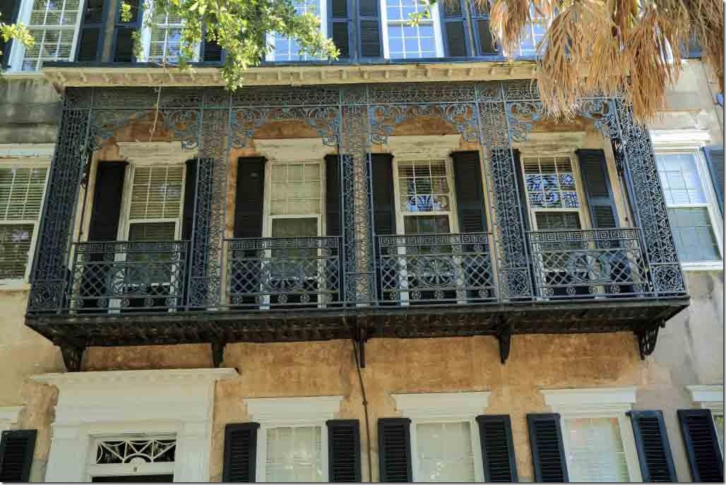 Charleston walk intricate iron work on balcony of Meeting Street home