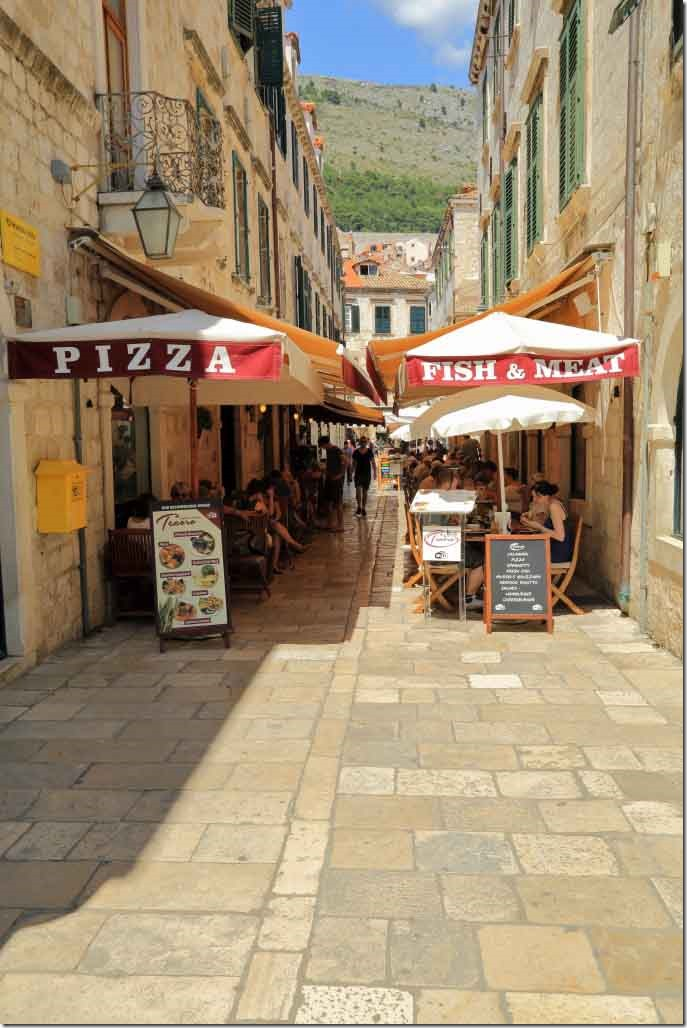 Dubrovnik Old Town narrow street with restaurants on both sides