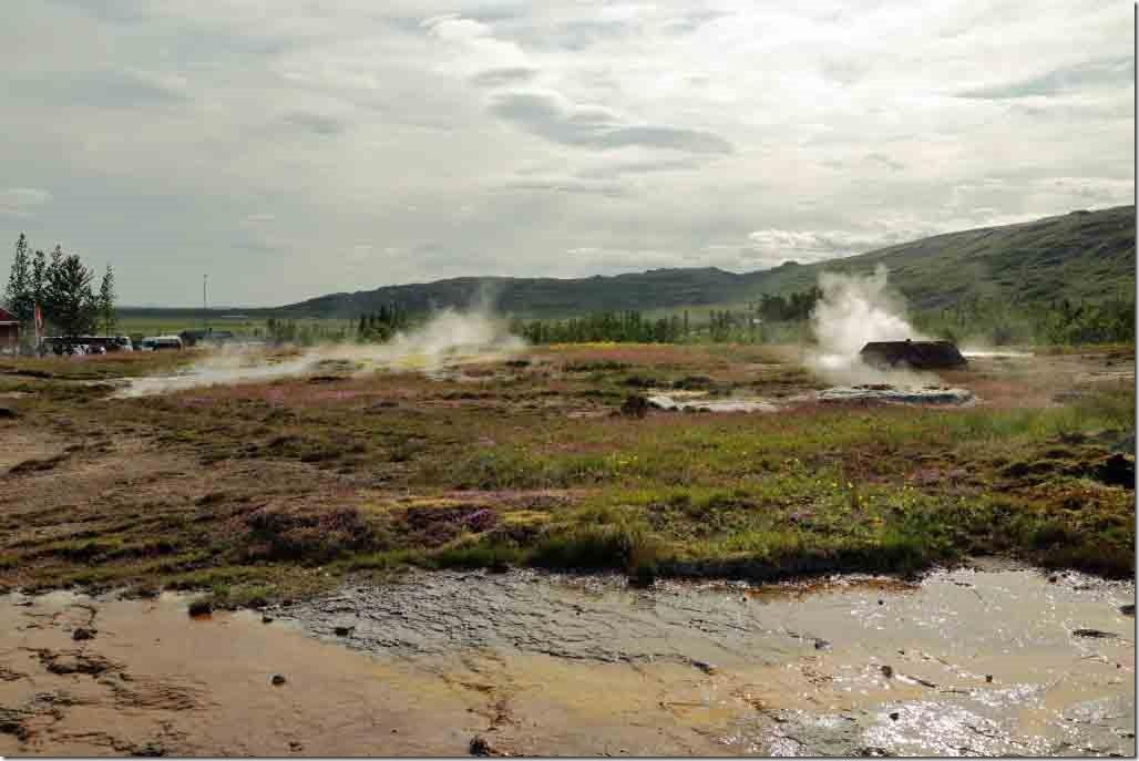 Geyser with other steam vents below the main geyser