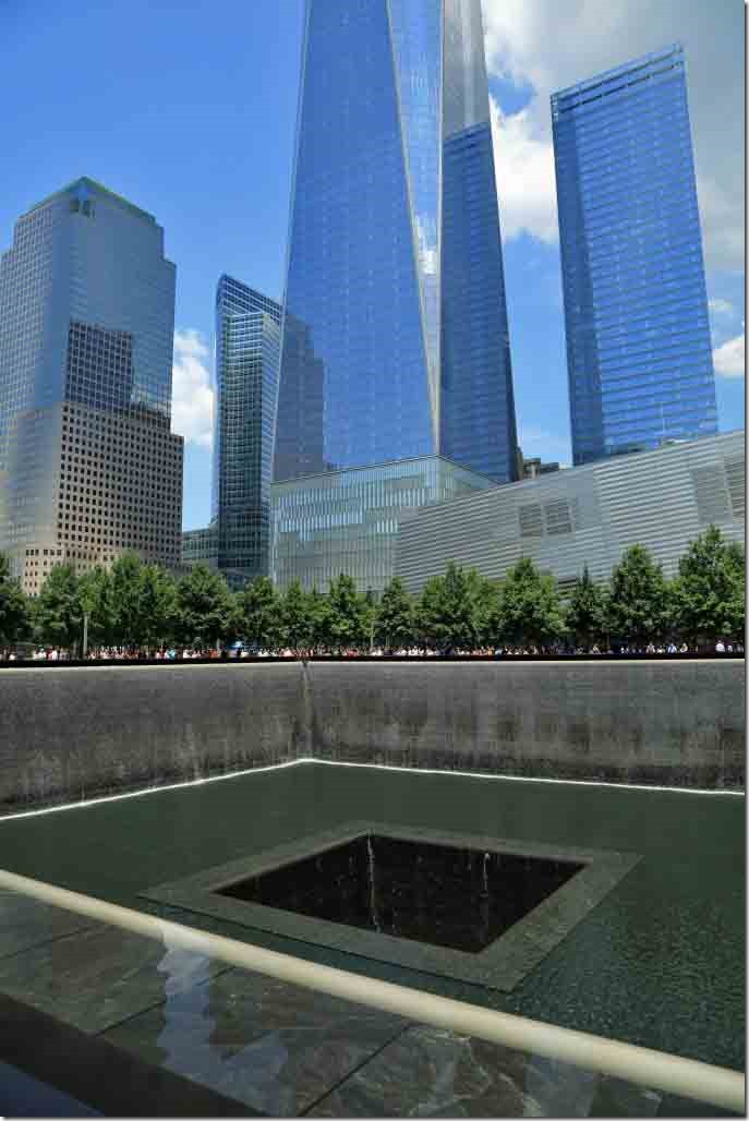 Ground Zero Twin Tower memorial with Freedom Tower in background