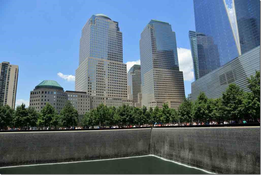 Ground Zero Twin Tower memorial with waterfront towers in background