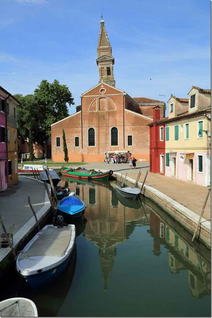 Tour Burano Island looking down the canal to the leaning tower church