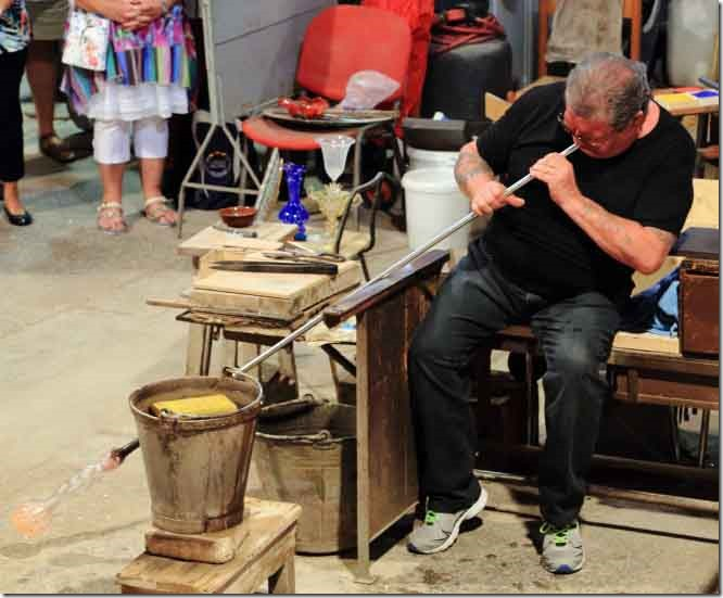 Tour Murano Glass Factory trademan blowing again to elongate the vase