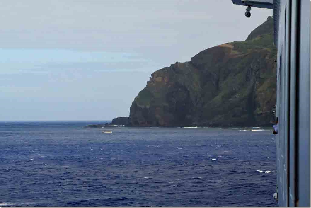 Approaching Pitcairn Island from the balcony with long boat approaching