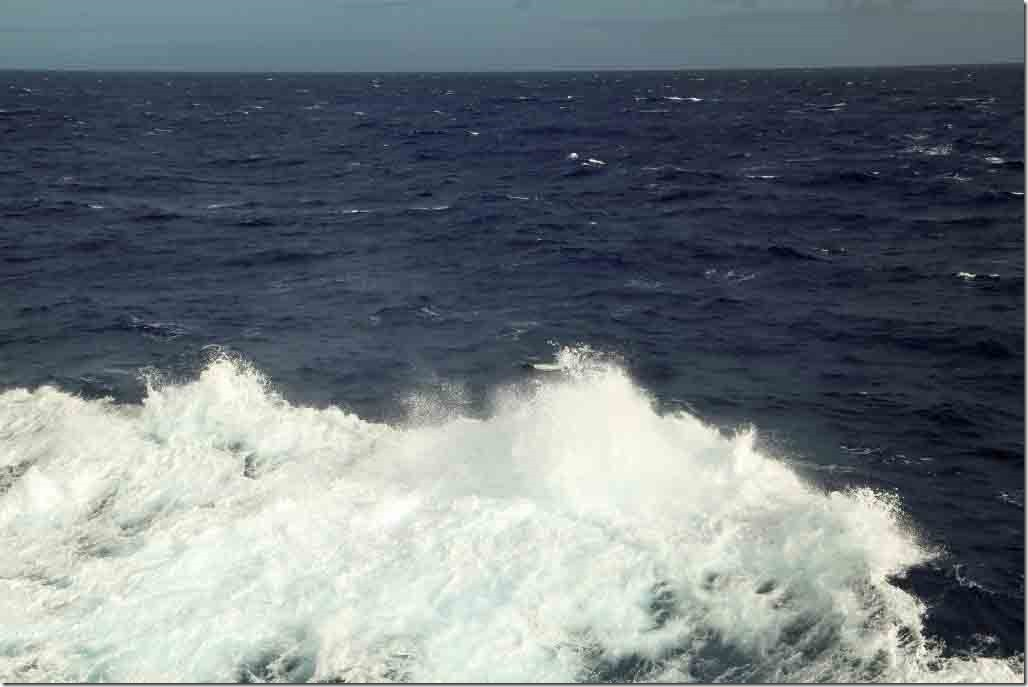 Approaching Pitcairn Island with 35 kt gale and ship's wash spray