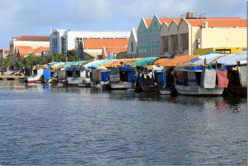 Fishing boats at the rear of the fruit and vegetable stalls