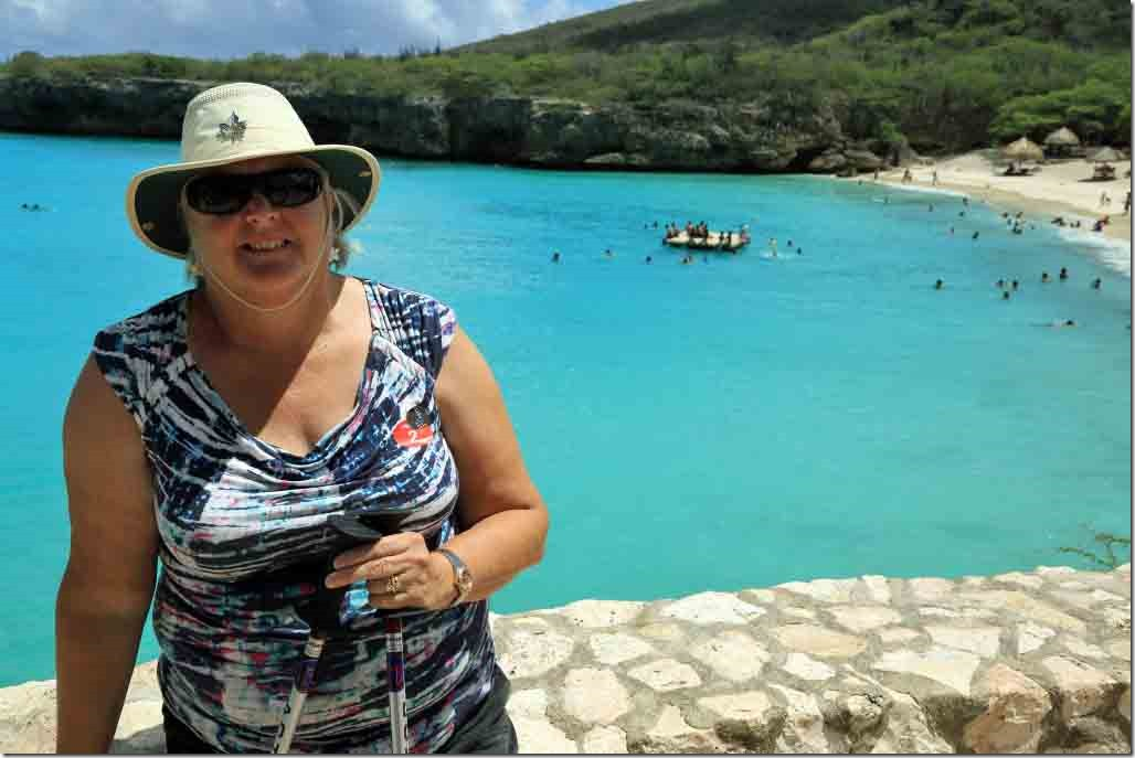 Knip Beach Judi sitting on the wall with the turquoise waters in the background
