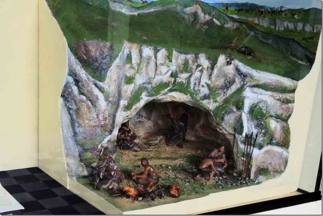 Museum display depicting the eveloution into living in caves