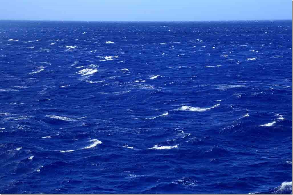 Scenic cruise around Pitcairn Island in 55 kt winds 3