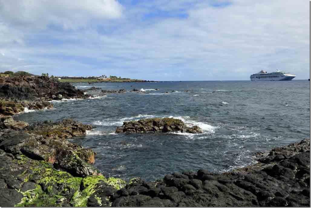 Walk - black lave shoreline with Sea Princess at anchor