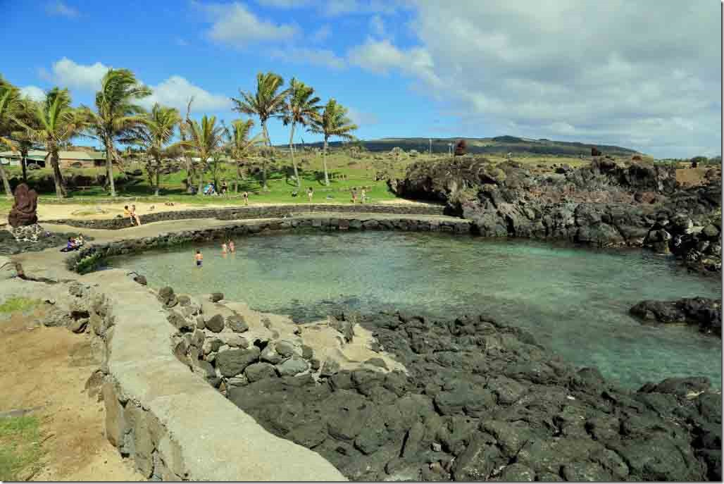 Walk - paddling pool surrounded by black lava on other side of downtown