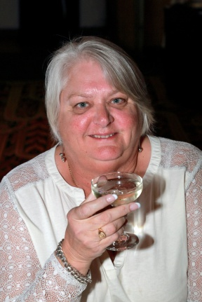 judi-enjoying-a-glass-of-bubbly