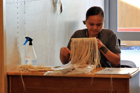 Apprentice centre weaver at work