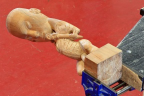 Apprentice centre wood carving in vice